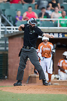 Home plate umpire Will Robinson calls a batter out on strikes during the Coastal Plain League game between the Asheboro Copperheads and the High Point-Thomasville HiToms at Finch Field on June 12, 2015 in Thomasville, North Carolina.  The HiToms defeated the Copperheads 12-3. (Brian Westerholt/Four Seam Images)