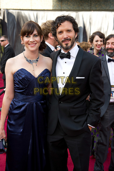 Bret McKenzie, Oscar®-nominee for Achievement in Music Written for Motion Pictures (Original Song), Oscar®-nominee for Best Animated Short Film, with guest .Arrivals at the 84th Annual Academy Awards® in Hollywood, CA., USA..February 26, 2012.*Editorial Use Only*.oscars half length tuxedo beard facial hair .CAP/A.M.P.A.S./NFS.©A.M.P.A.S. Supplied by Capital Pictures.