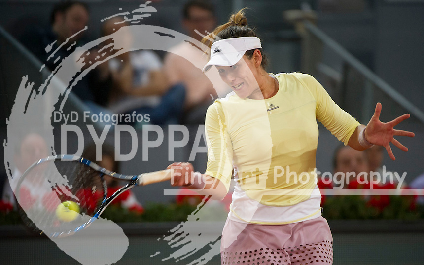 Spanish tennis player Garbine Muguruza returns the ball