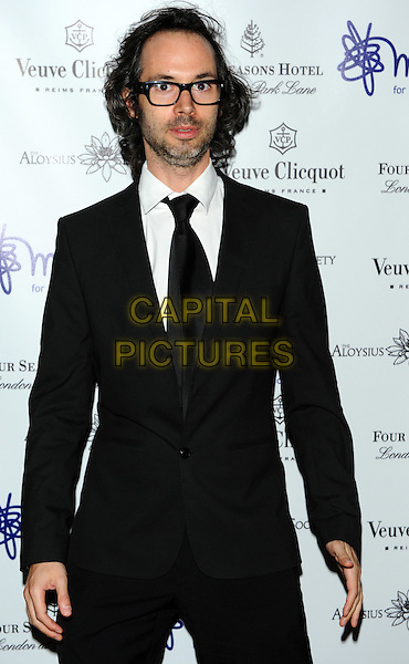 James Rhodes.'Mindful' gala exhibition and gala dinner to raise funds for the Mind creative therapies fund, Imperial War Museum, London, England..September 21st, 2011.half length black white shirt glasses beard facial hair tie tuxedo .CAP/CJ.©Chris Joseph/Capital Pictures.