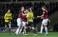 Tempers flair during the Sky Bet League 2 match between Oxford United and Northampton Town at the Kassam Stadium, Oxford, England on 16 February 2016. Photo by Andy Rowland.