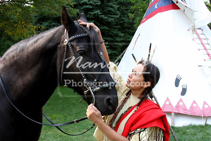 Native American Indian woman bonding with her horse