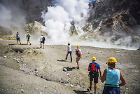 Tourists exploring White Island Volcano, an active volcano in the Bay of Plenty, North Island, New Zealand