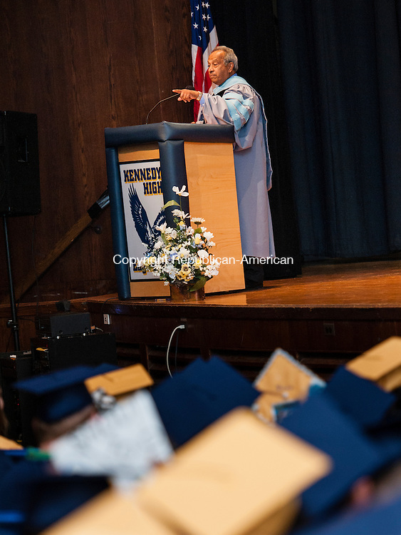 WATERBURY, CT-17 June 2014-061714EC17-  Dr. Paul Sequeira, a special advisor to the Superintendent who is retiring this year, addresses the graduates Kennedy High School graduation Tuesday night. Erin Covey Republican-American