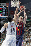 Real Madrid's Gustavo Ayon (l) and FC Barcelona's Justin Doellman during Liga Endesa ACB 2nd Final Match.June 21,2015. (ALTERPHOTOS/Acero)