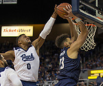 Nevada forward  Tre'Shawn Thurman (0) blocks the shot of Akron forward Jaden Sayles (23) in the second half of an NCAA college basketball game in Reno, Nev., Saturday, Dec. 22, 2018. (AP Photo/Tom R. Smedes)