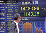 May 23, 2013, Tokyo, Japan - A passerby gives a glance at the stock price board as Japan stock prices plunged 7.3 percent, the biggest one-day drop in 13 years, on the Tokyo Stock Exchange market on Thursday, May 23, 2013. The Nikkei ended at 14,483.98, 1,143.28 points lower in the 11th-largest point drop on record.  (Photo by Natsuki Sakai/AFLO)