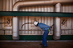 ITUMBIARA, BRAZIL - OCTOBER 16:<br /> Clodoaldo Barros (cq), coordinator of industrial process checks the broiler which uses &quot;bagasse&quot; - waste from sugarcane stalks to power the plant at a Cargill facility, near the city of Itumbiara, in Goias state, Brazil, on Wednesday, Oct. 16, 2013. Since the US recently passed a number of regulations and standards for cars and dropped tariffs that were in place for decades against Brazilian sugar, Brazilian ethanol is now flowing to the U.S., and the ethanol industry in the country is consolidating and ramping up for a new era.