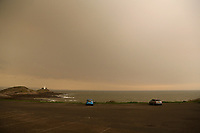 An unusually orange cloud over Mumbles Lighthouse at the seaside village of Mumbles