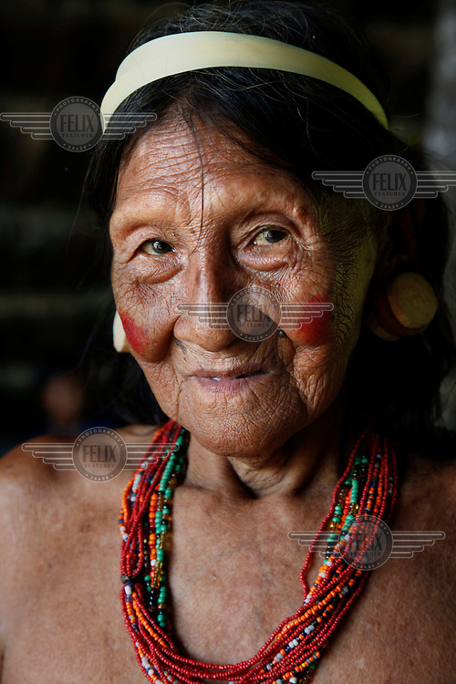 Portrait of a Huaorani woman in traditional dress. The Huaorani (also known as Waodani) are trying to protect their land against the threat of oil multinationals by pursuing ecotourism.