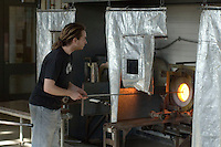 Heating glass in the furnace, Ceramics Dept. at University College for the Creative Arts, Farnham.