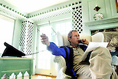 United States President George W. Bush talks during a phone call with Russian President Vladimir Putin at the Bush family home  at Walker's Point in Kennebunkport, Maine, Friday, July 6, 2001.<br /> Mandatory Credit: Eric Draper / White House via CNP