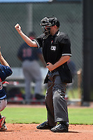 Umpire Kyle Zirbes makes a call during a game between the GCL Red Sox and GCL Rays on June 24, 2014 at Charlotte Sports Park in Port Charlotte, Florida.  GCL Red Sox defeated the GCL Rays 5-3.  (Mike Janes/Four Seam Images)