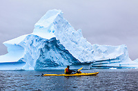 Sea kayaking among the blue ice near Pleneau Island along the Antarctic Peninsula.