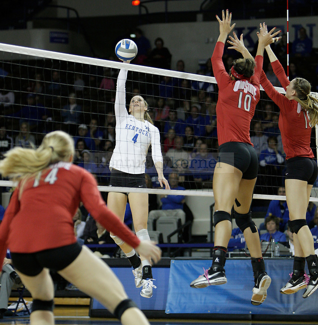Senior Ashley Frazier (4) hits the ball during the UK women's volleyball game v. Ohio University during the second round of the NCAA tournament in Memorial Coliseum in Lexington, Ky., on Saturday, December 1, 2012. Photo by Genevieve Adams | Staff