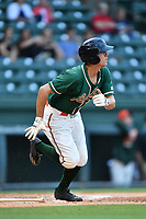 Center fielder Corey Bird (18) of the Greensboro Grasshoppers runs toward first in a game against the Greenville Drive on Tuesday, April 25, 2017, at Fluor Field at the West End in Greenville, South Carolina. Greenville won, 5-1. (Tom Priddy/Four Seam Images)