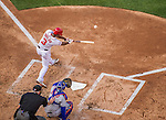 6 April 2015: Washington Nationals outfielder Michael Taylor connects in the third inning of the Home Opening Game against the New York Mets at Nationals Park in Washington, DC. The Mets rallied to defeat the Nationals 3-1 in their first meeting of the 2015 MLB season. Mandatory Credit: Ed Wolfstein Photo *** RAW (NEF) Image File Available ***
