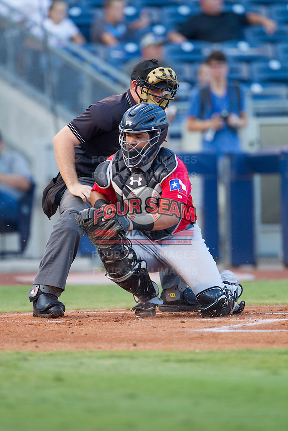 Frisco RoughRiders catcher Jorge Alfaro (8) reaches for a wild pitch in front of home plate umpire Jake Wilburn during the Texas League game at ONEOK field on August 15, 2014 in Tulsa, Oklahoma  The RoughRiders defeated the Drillers 8-2.  (William Purnell/Four Seam Images)