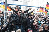 Ca. 1000 Neonazis, Skinheads und Hooligans demonstrierten am Tag der Deutschen Einheit in Berlin unter dem Motto &quot;Wir fuer Deutschand - Merkel muss weg&quot; in Berlin.<br /> 3.10.2018, Berlin<br /> Copyright: Christian-Ditsch.de<br /> [Inhaltsveraendernde Manipulation des Fotos nur nach ausdruecklicher Genehmigung des Fotografen. Vereinbarungen ueber Abtretung von Persoenlichkeitsrechten/Model Release der abgebildeten Person/Personen liegen nicht vor. NO MODEL RELEASE! Nur fuer Redaktionelle Zwecke. Don't publish without copyright Christian-Ditsch.de, Veroeffentlichung nur mit Fotografennennung, sowie gegen Honorar, MwSt. und Beleg. Konto: I N G - D i B a, IBAN DE58500105175400192269, BIC INGDDEFFXXX, Kontakt: post@christian-ditsch.de<br /> Bei der Bearbeitung der Dateiinformationen darf die Urheberkennzeichnung in den EXIF- und  IPTC-Daten nicht entfernt werden, diese sind in digitalen Medien nach &sect;95c UrhG rechtlich geschuetzt. Der Urhebervermerk wird gemaess &sect;13 UrhG verlangt.]
