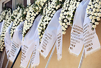 "Pictured:Floral tributes for Marios Souloukos at his funeral the Acharnes Cemetery, Athens, Greece. Saturday 10 June 2017<br /> Re: An 11 year old boy has been shot dead by a ""stray bullet"" during a school celebration in Acharnes (Menidi) area, in the outskirts of Athens, Greece.<br /> Marios Dimitrios Souloukos ""complained to his mum"" who works as a teacher at the 6th Primary School of Acharnes that he was feeling unwell, he then collapsed with blood pouring out from the top of his head.<br /> His mum tried to revive him assisted by other teachers while his schoolmates who were reportedly upset, were hurriedly removed by their parents.<br /> According to locals an ambulance arrived 25 minutes late.<br /> Hundreds of police officers have been deployed in the area and have raided many properties.<br /> Shells matching the fatal bullet which hit the boy on the top of his head were found in a house yard nearby.<br /> Local people reported hearing shots being fired at a nearby Romany Gypsy camp before the fatal incident.<br /> The area has been plagued with criminality during the last few years."