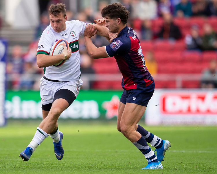 London Irish's Theo Brophy Clews evades the tackle of Bristol Bears' Piers O'Conor<br /> <br /> Photographer Bob Bradford/CameraSport<br /> <br /> Premiership Rugby Cup Round Three - Bristol Bears v London Irish - Sunday 6th October 2019 - Ashton Gate - Bristol<br /> <br /> World Copyright © 2018 CameraSport. All rights reserved. 43 Linden Ave. Countesthorpe. Leicester. England. LE8 5PG - Tel: +44 (0) 116 277 4147 - admin@camerasport.com - www.camerasport.com