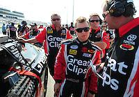 May 2, 2008; Richmond, VA, USA; NASCAR Nationwide Series driver Jason Leffler (center) talks with his crew during the Lipton Tea 250 at the Richmond International Raceway. Mandatory Credit: Mark J. Rebilas-