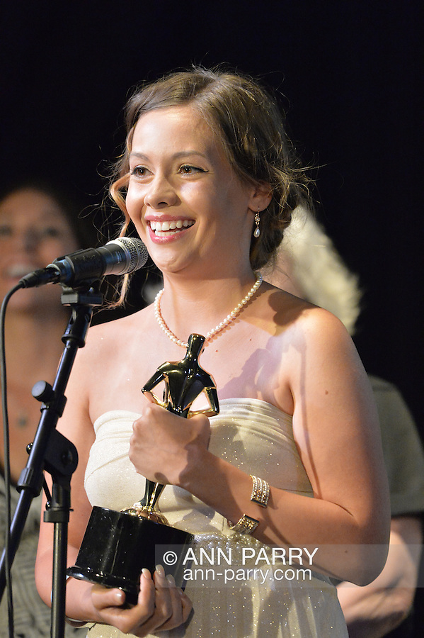 "Bellmore, New York, USA. July 21, 2016. ROSALIE DEVEREAUX GAFFNEY - the writer, producer and director of the movie short ""En Pointe"" - accepts trophy for Best Student Film, which tied with the short film Un-Sexy, at the19th Annual Long Island International Film Expo Awards Ceremony, LIIFE 2016, held at the historic Bellmore Movies. Actor KEVIN BROWN (Dot Com in 30 Rock) once again was host. ""En Pointe"" made its New York debut at LIIFE. LIIFE was called one of the 25 Coolest Film Festivals in the World by MovieMaker Magazine."