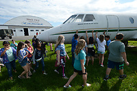 NWA Democrat-Gazette/ANDY SHUPE<br /> Students from Lowell Elementary School reach to touch a A Dassault Falcon 20 on display Tuesday, May 14, 2019, as they tour the Arkansas Air and Military Museum in Fayetteville. The students spent the morning learning about flight and the history of aviation in Northwest Arkansas.