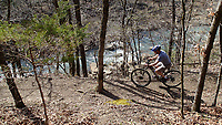 NWA Democrat-Gazette/FLIP PUTTHOFF <br /> A rider navigates the Fossil Flats Trail above Lee Creek on April 6 2019 during the Ozark Mountain Bike Festival.