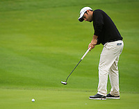 14.10.2014. The London Golf Club, Ash, England. The Volvo World Match Play Golf Championship.  Alexander Levy [FRA] putts on the seventh hole during the Pro-Am event.