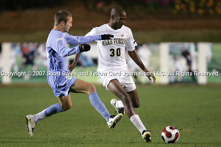 16 November 2007: North Carolina's Brian Shriver (left) challenges Wake Forest's Lyle Adams (30) for the ball. Wake Forest University played the University of North Carolinaat SAS Stadium in Cary, NC in an Atlantic Coast Conference Men's Soccer tournament semifinal.