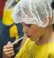 NWA Democrat-Gazette/ANTHONY REYES • @NWATONYR<br /> Matthew Rogers, 6, samples chocolate Thursday, Sept. 24, 2015 at the KYYA chocolate factory in Elm Springs. Matthew joined other NWA Social Homeschoolers for the tour. The students learned how they make chocolate in the factory, where they get their coco beans from and they got to make a bar of milk chocolate themselves.