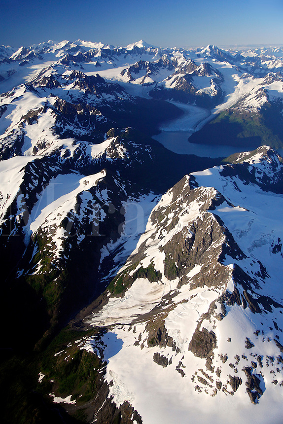 Aerial of Meares Glacier with Unakwik Inlet (R) and Harvard Glacier with College Fiord (L), Chugach Mountains, Prince William Sound, Chugach National Forest, Alaska.