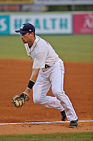 New Orleans Zephyrs first baseman Vinny Rottino (4) fields a ball against the Albuquerque Isotopes in a game at Zephyr Field on May 28, 2015 in Metairie, Louisiana. (Derick E. Hingle/Four Seam Images)