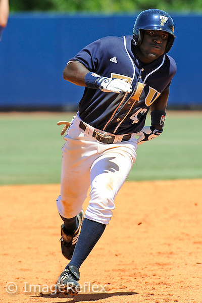 19 April 2009:  FIU's Lammar Guy (42) rounds third on the way home in the New Orleans 11-10 (8 innings) victory over FIU at University Park Stadium in Miami, Florida.