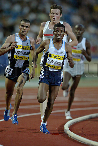 30 July 2004: Ethiopian runner Haile Gebrselassie (ETH) leads the pack in the Men's 5000m race during the Norwich Union London Grand Prix held at Crystal Palace, London. Gebrselassie won the race in a time of 12:55.51. Photo: Neil Tingle/Action Plus..040730 athletics athlete man men male run running runner runs track event distance