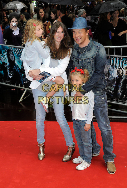 "JOOLS OLIVER, JAMIE OLIVER & children Poppy Honey and Daisy Boo.Arriving at the World Premiere of ""Harry Potter and the Half-Blood Prince"" at the Odeon cinema, Leicester Square, London, England, UK, July 7th 2009..Half Blood Full length jeans gold ankle boots daughters kids family jeans blue fedora hat denim jacket .CAP/FIN.©Steve Finn/Capital Pictures"