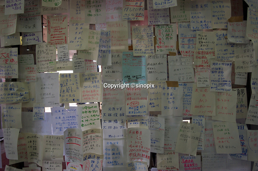 Messages are sticked on board for people searching their missing relatives in Natori, near Sendai, Japan. The earthquake on 11 March 2011 in Japan is one of the biggest earthquakes ever recorded, it had killed thousands of people. The death toll was expected to rise dramatically, with tens of thousands reported missing..16 Mar 2011..