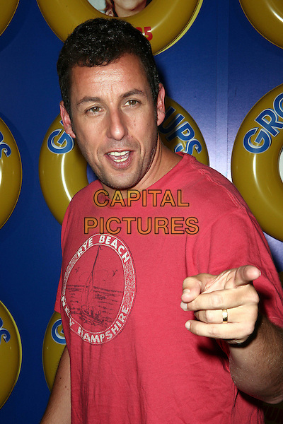 ADAM SANDLER.The screening of 'Grown Ups' at the Ziegfeld Theatre in New York City, NY, USA, 23rd June 2010..arrivals half length red t-shirt hand finger pointing .CAP/ADM/PZ.©Paul Zimmerman/AdMedia/Capital Pictures.
