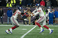 FOXBORO, MA - OCTOBER 10: New York Giants Quarterback Daniel Jones (8) hands off to New York Giants Runningback Jon Hilliman (28) during a game between New York Giants and New England Patriots at Gillettes on October 10, 2019 in Foxboro, Massachusetts.