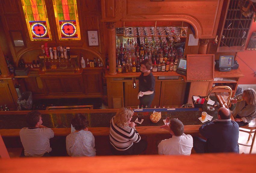 PATRONS OF THE NORTHLAND PUB IN THE LANDMARK INN IN MARQUETTE MICHIGAN.