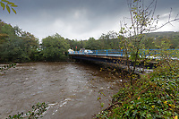 Pictured: The swollen Neath river by Tonna, Wales, UK. Tuesday 01 October 2019<br /> Re: Heavy rain and strong winds caused by Hurricane Lorenzo affect parts of the UK.