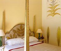 The bed and bedroom walls have been hand-painted by Emma Foale with gold motifs