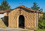 A small Catholic church made of adobe bricks in a little village in the Sierra Juarez Mountains of Oaxaca, Mexico.