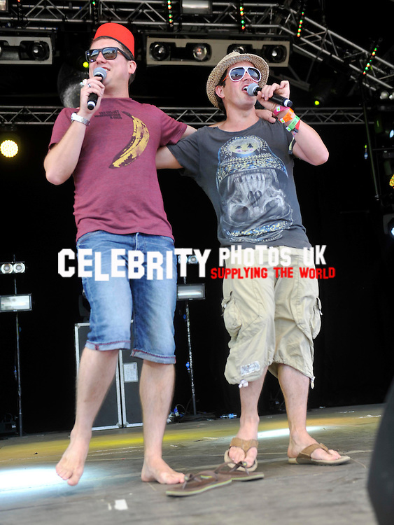 Dick and Dom  live on stage at camp bestival 28/7/2012Picture By: Brian Jordan / Retna Pictures.. ..-..