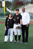 Kannapolis Intimidators catcher Nate Nolan (22) poses for a photo with Alice Harrison (left), CEO of Hope Haven Inc., and former Major League Baseball star Darryl Strawberry prior to the game against the Lakewood BlueClaws at Kannapolis Intimidators Stadium on April 6, 2017 in Kannapolis, North Carolina.  The BlueClaws defeated the Intimidators 7-5.  (Brian Westerholt/Four Seam Images)