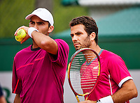 France, Paris , May 27, 2015, Tennis, Roland Garros, Mens doubles: Jean Julien Rojer (NED)(R) and his partner Horia Tecau (ROU)<br /> Photo: Tennisimages/Henk Koster