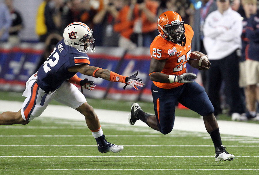 ATLANTA, GA - DECEMBER 31: Perry Jones #33 of the Virginia Cavaliers runs past Demetruce McNeal #12 of the Auburn Tigers during the 2011 Chick Fil-A Bowl at the Georgia Dome on December 31, 2011 in Atlanta, Georgia. Auburn defeated Virginia 43-24. (Photo by Andrew Shurtleff/Getty Images) *** Local Caption *** Perry Jones;Demetruce McNeal
