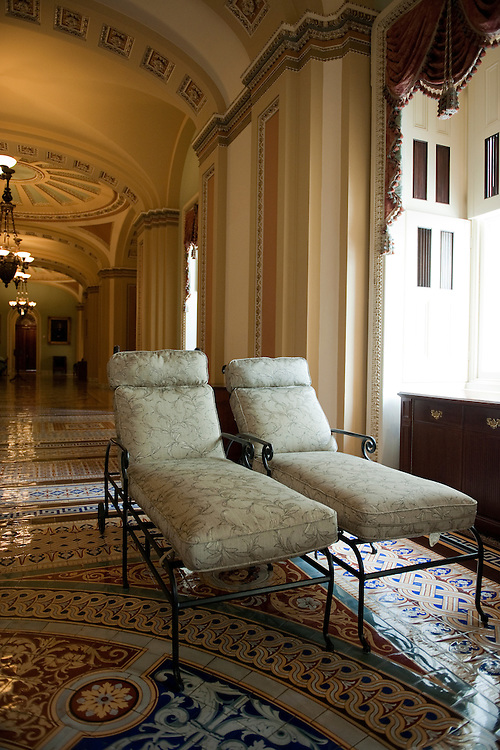 UNITED STATES - AUGUST 26:  Patio furniture sits in the Capitol's Ohio Clock Corridor after being taken off the balcony of Senate Minority Leader Mitch McConnell, R-Ky., in anticipation of the arrival of Hurricane Irene.  (Photo By Tom Williams/Roll Call)