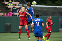 Seattle, WA - Saturday, May 14, 2016: Portland Thorns FC midfielder Dagny Brynjarsdottir (11), left, and Seattle Reign FC defender Rachel Corsie (4) go up for a header during the first half. The Portland Thorns FC and the Seattle Reign FC played to a 1-1 tie during a regular season National Women's Soccer League (NWSL) match at Memorial Stadium.